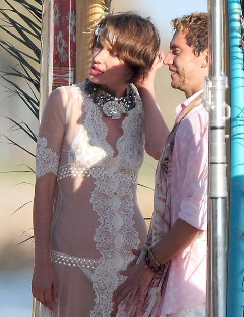 Textile, Happy, Interaction, Dress, Bridal clothing, Love, Marriage, Embellishment, Bride, Wedding dress,