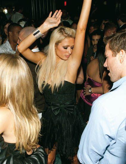 Hair, Face, Arm, Mammal, Dress, Party, Blond, Dance, Music venue, Strapless dress,