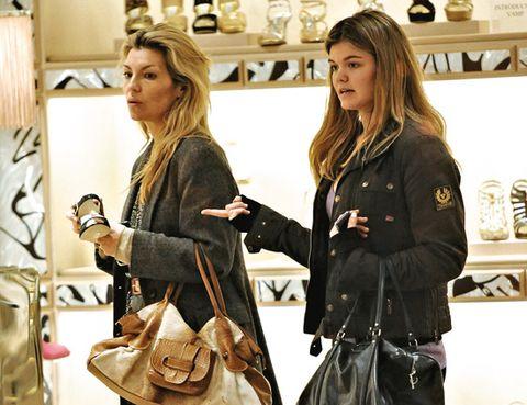 Hair, Fashion, Long hair, Leather, Service, Blond, Interior design, Shelf, Bag, Belt,