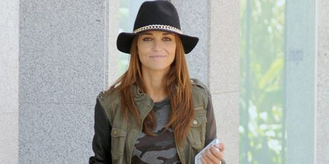 Clothing, Brown, Sleeve, Hat, Human body, Textile, Bag, Joint, Outerwear, Fashion accessory,