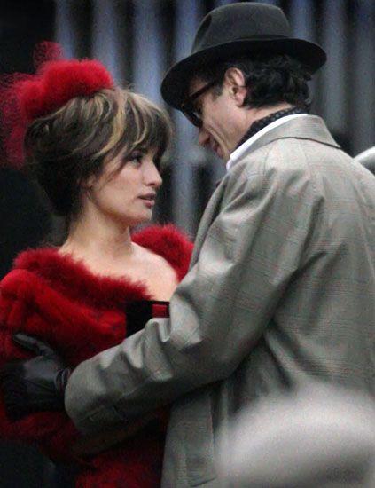 Hat, Coat, Outerwear, Style, Formal wear, Interaction, Headgear, Suit, Fashion, Blazer,