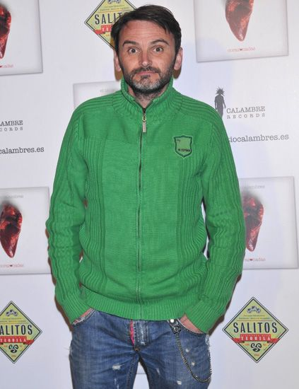 Green, Denim, Sleeve, Trousers, Jeans, Jacket, Textile, Facial hair, Standing, Red,