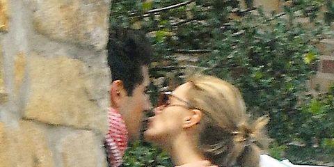 Ear, Hairstyle, People in nature, Interaction, Romance, Love, Kiss, Gesture, Honeymoon, Long hair,