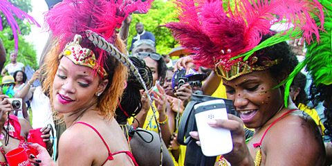 People, Event, Entertainment, Performing arts, Hat, Fashion accessory, Headgear, Tradition, Abdomen, Carnival,