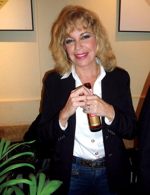 Denim, Drink, Bottle, Alcoholic beverage, Picture frame, Alcohol, Beer, Glass bottle, Blond, Drinking,