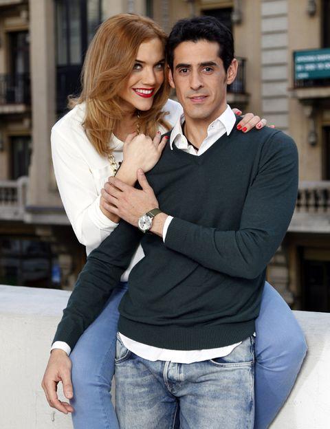 Trousers, Denim, Jeans, Outerwear, Interaction, Love, Fashion accessory, Wrist, Street fashion, Romance,