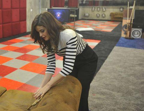 Flooring, Floor, Human leg, Tile, Thigh, Waist, Television, Long hair, Brown hair, Foot,