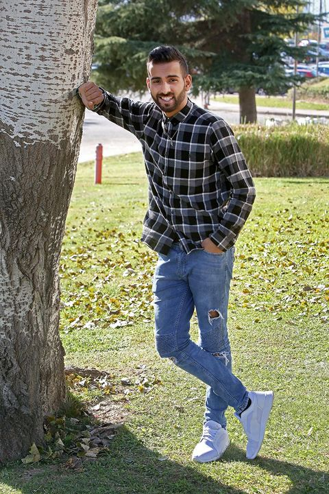 Jeans, Tree, Grass, Denim, Standing, Woody plant, Branch, Plant, Outerwear, Lawn,