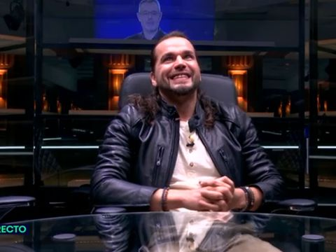 Jacket, Sitting, Leather, Facial hair, Leather jacket, Beard, Laugh, Cuff, Top, Moustache,