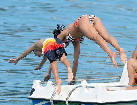 Human leg, Water, Elbow, Leisure, Summer, Watercraft, Thigh, Waist, Swimwear, Calf,