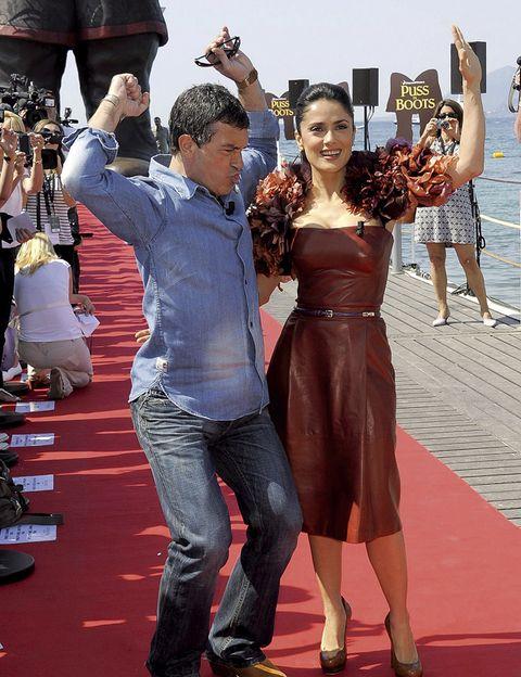 Arm, Shirt, Red, Dress, Flooring, Carpet, Strapless dress, One-piece garment, Belt, Gesture,