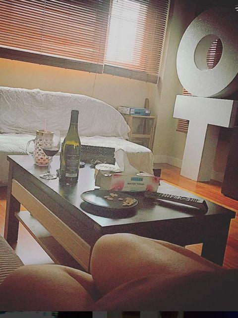 Drinkware, Glass bottle, Drink, Table, Bottle, Glass, Interior design, Furniture, Window covering, Wine bottle,