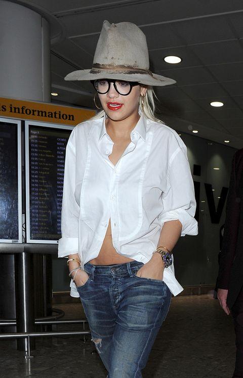 Clothing, Brown, Hat, Denim, Sleeve, Trousers, Jeans, Dress shirt, Textile, Shirt,