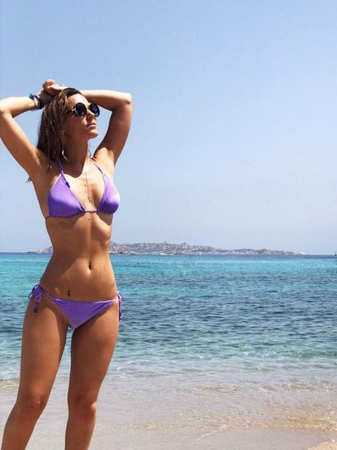 Clothing, Body of water, Brassiere, Swimwear, Shoulder, Swimsuit top, Coastal and oceanic landforms, Photograph, Joint, Swimsuit bottom,