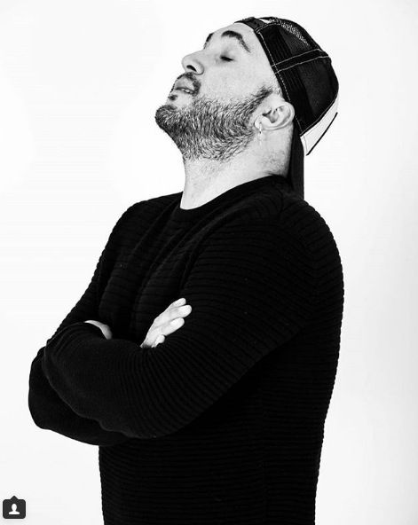 Facial hair, Sleeve, Shoulder, Elbow, Standing, Beard, Style, Jaw, Sweater, Monochrome,