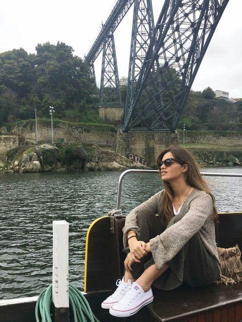 Sunglasses, Waterway, Goggles, Bridge, Truss bridge, Sitting, Bag, Travel, Channel, Girder bridge,