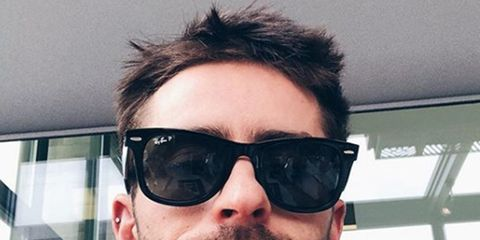 Eyewear, Glasses, Facial hair, Vision care, Finger, Hairstyle, Sunglasses, Chin, Eyebrow, Moustache,