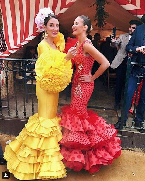 Yellow, Flag, Dress, Entertainment, Performing arts, Red, Formal wear, Gown, One-piece garment, Fashion,