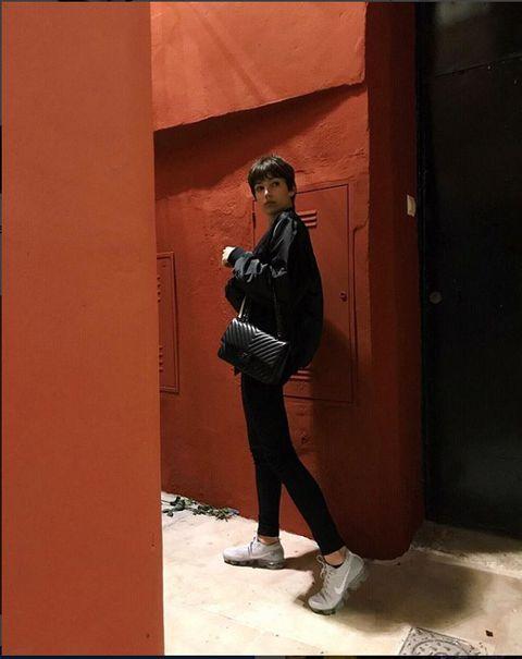 Leg, Photograph, Standing, Street fashion, Bag, Jacket, Photography, Luggage and bags, Tints and shades, Snapshot,
