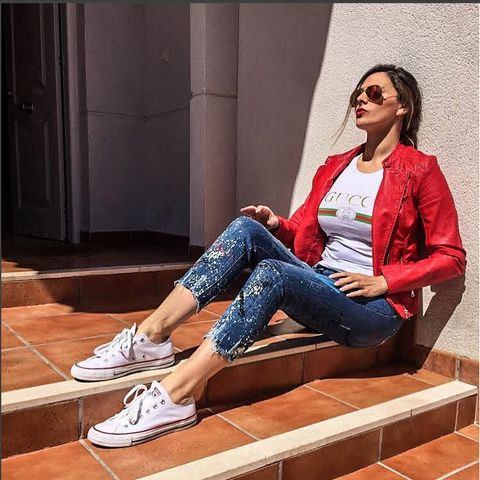 Leg, Shoe, Human leg, Denim, Jeans, Sunglasses, Outerwear, Sitting, Style, Street fashion,