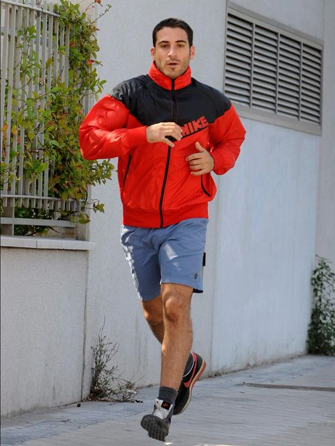 Clothing, Sleeve, Human leg, Textile, Joint, Outerwear, Sportswear, Red, T-shirt, Jacket,