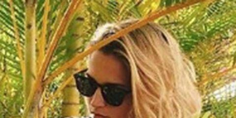Clothing, Eyewear, Glasses, Vision care, Hairstyle, Sunglasses, Sleeve, Photograph, White, Style,