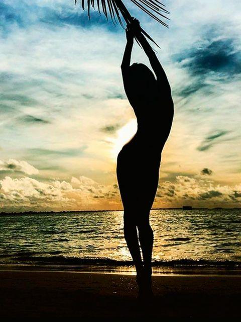 Sky, Cloud, People in nature, Horizon, Sunset, Ocean, Sunlight, Beach, Silhouette, Waist,