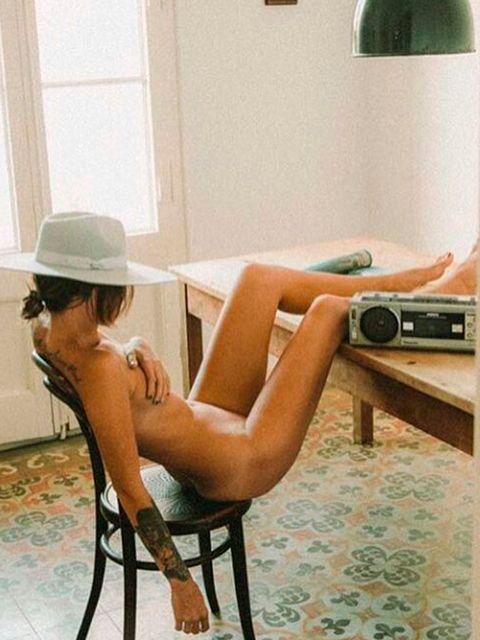 Human leg, Room, Furniture, Sitting, Home appliance, Thigh, Photography, Fedora, Sun hat, Calf,