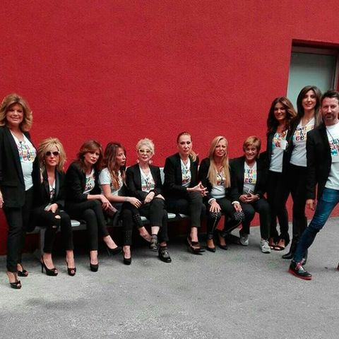 Hair, Footwear, People, Social group, Red, Team, Street fashion, Collaboration, Pantsuit,