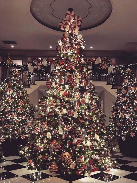 Event, Interior design, Christmas decoration, Room, Christmas tree, Red, Christmas ornament, Interior design, Holiday ornament, Home,