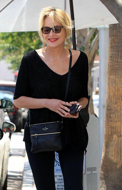 Eyewear, Glasses, Vision care, Sleeve, Shoulder, Sunglasses, Bag, Style, Fashion accessory, Street fashion,