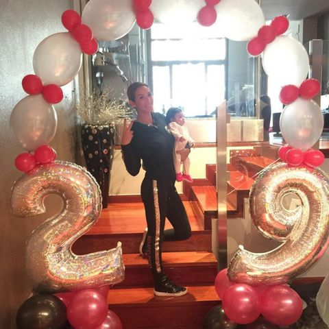 Human, Human body, Party supply, Balloon, Red, Suit, Boot, Decoration, Party, Sphere,