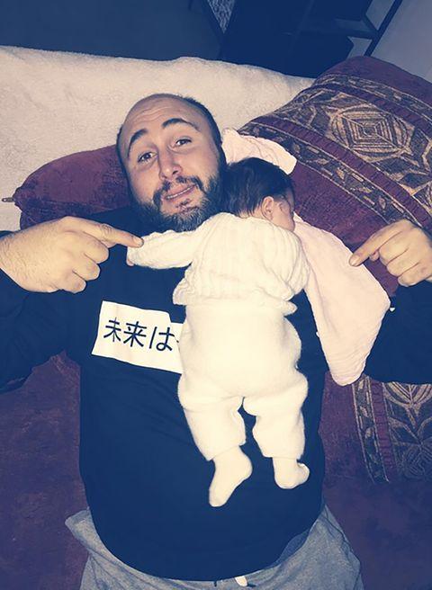 Beard, Interaction, Facial hair, Baby & toddler clothing, Moustache, Umbrella, Love, Gesture, Baby, Hug,