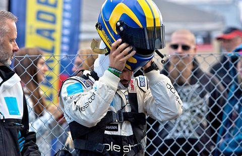 Helmet, Sports gear, Personal protective equipment, Sportswear, Jersey, Player, Glove, Sports jersey, Motorcycle helmet, Fence,