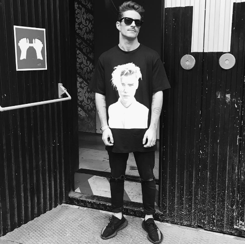 White, Black, Photograph, Eyewear, Standing, Black-and-white, Fashion, Snapshot, Sunglasses, T-shirt,