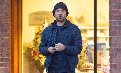 Human body, Winter, Jacket, Textile, Brick, Cap, Facial hair, Street fashion, Beard, Brickwork,