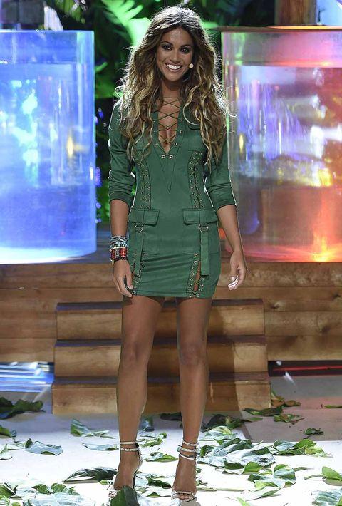 Human, Green, Human leg, Dress, Style, Fashion accessory, Display device, Fashion model, Fashion show, Fashion,