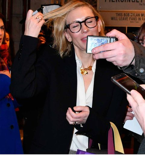 Hand, Fashion accessory, Nail, Blazer, Mobile phone, Thumb, Blond, Brown hair, Mobile device, Drinking,