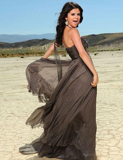 Clothing, Shoulder, Landscape, Dress, Formal wear, Gown, Sand, Aeolian landform, Youth, Day dress,