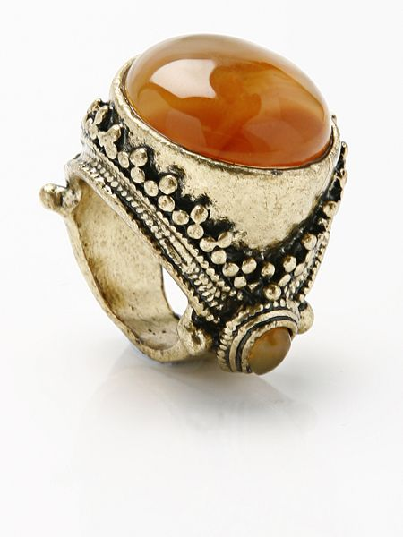 Jewellery, Amber, Fashion accessory, Metal, Body jewelry, Beige, Gemstone, Natural material, Ring, Amber,