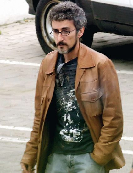Jacket, Sleeve, Automotive tire, Facial hair, Textile, Shirt, Outerwear, Coat, Beard, Fender,
