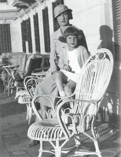 Furniture, Hat, Chair, Sitting, Vintage clothing, Monochrome, Sun hat, Classic, Fedora, Retro style,