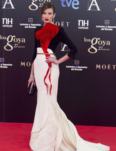 Clothing, Human, Flooring, Shoulder, Red, Dress, Formal wear, Style, Fashion model, Carpet,