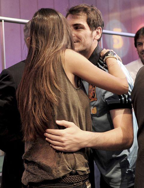 Interaction, Long hair, Brown hair, Gesture, Love, Layered hair, Leather, Belt, Hug, Hip,