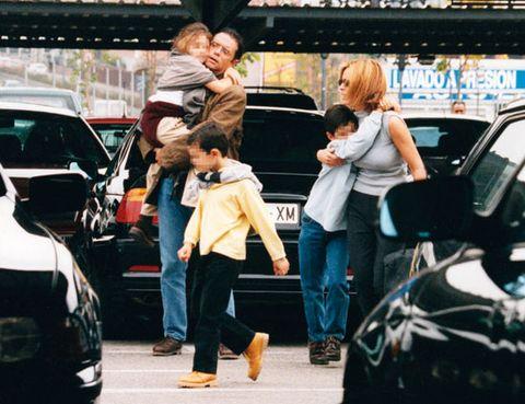 Land vehicle, Jeans, Jacket, Street fashion, Denim, Street, Bag, Luggage and bags, Vehicle door, Automotive window part,