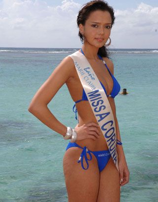 Clothing, Blue, Hairstyle, Skin, Brassiere, Shoulder, Swimwear, Swimsuit top, Bikini, Joint,