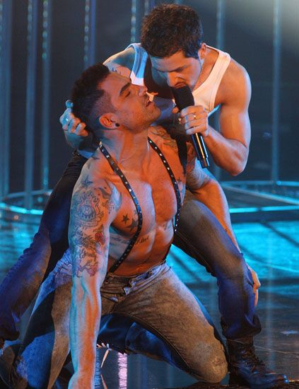 Human body, Chest, Barechested, Muscle, Trunk, Artist, Performance art, Boot, Singing, Back,
