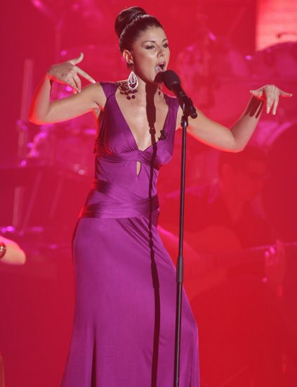 Microphone, Audio equipment, Music, Entertainment, Performing arts, Electronic device, Music artist, Dress, Singing, Magenta,