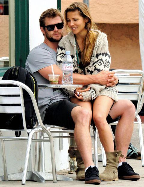 Eyewear, Leg, Human body, Goggles, Human leg, Sitting, Sunglasses, Drink, Summer, Chair,