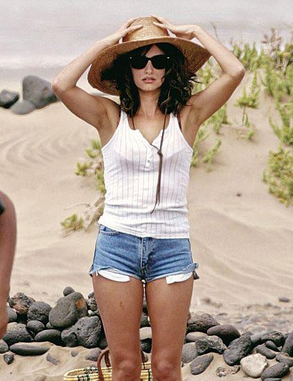 Clothing, Eyewear, Human body, Denim, Shoulder, Sand, Landscape, jean short, Rock, Hat,